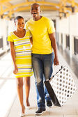 Young african couple in shopping center — Stock Photo