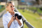 Thoughtful amateur photographer holding camera — Stock Photo