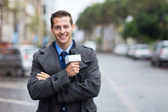 Confident news reporter outdoors in the rain — Stock Photo