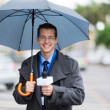 Stock Photo: News reporter live broadcasting in rain