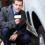 Paparazzi hiding behind a car — Stock Photo #34910893
