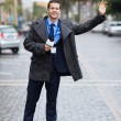 Journalist waiting for a cab — Stock Photo