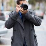 Постер, плакат: Photographer taking street photos