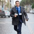 Journalist running on urban street — Stock Photo