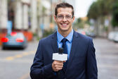 News reporter live broadcasting on street — Stock Photo