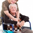 Loving senior wife hugging disabled husband  — Stock Photo
