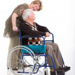 Senior woman talking to her disabled husband — Stock Photo