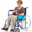 Handicapped senior woman using smart phone — Stock Photo