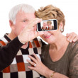 Senior couple taking self portrait with smart phone — Stock Photo
