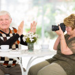 Senior man refusing to be photographed — Stock Photo