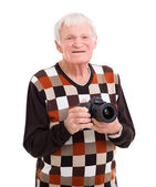 Happy senior man holding a camera — Stock Photo