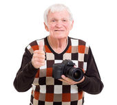Senior photographer giving thumb up — Stock Photo