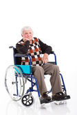 Disabled senior man sitting on a wheelchair — Stock Photo