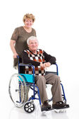 Disabled old man sitting on wheelchair with caring wife — Stock Photo