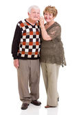 Retired couple using mobile phone — Stock Photo