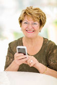 Senior woman using smart phone — Stock Photo