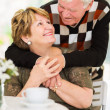 Senior couple embracing — Stockfoto