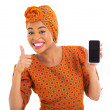 African girl holding cell phone and thumb up — Stock Photo