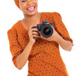 Stock Photo: Young africwomholding digital SLR camera
