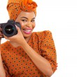 African girl holding a digital camera — Stock Photo