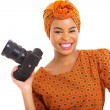 Stock Photo: African woman holding a digital SLR camera