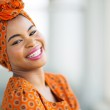 African woman wearing traditional attire — Stock Photo #36379599