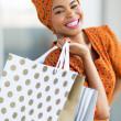 Постер, плакат: African woman shopping spree in mall