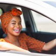 Young african woman in a car — Stock Photo #36379893