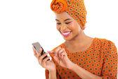 African american woman using smart phone — ストック写真
