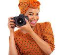 African girl holding a digital camera — Stock fotografie