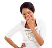 African woman covering her mouth and laughing — Стоковое фото