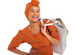 Happy black woman carrying shopping bags — Stock Photo