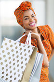 African woman shopping spree in mall — Stock Photo