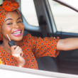 African woman showing car key — Stock Photo #36380061