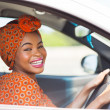 Africfemale driver inside car — Stock Photo #36380275