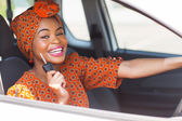African woman showing car key — Stock Photo
