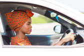 Young african woman driving a car — Stock Photo