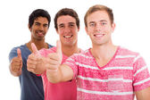 Group of friends giving thumbs up — Stock Photo