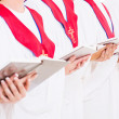 Stock Photo: Church choir holding hymn books