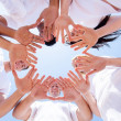 Underneath view of people hands together — Stockfoto #38475045