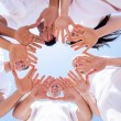 Foto Stock: Underneath view of people hands together