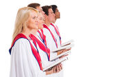 Church choir singing from hymnal — Stock Photo