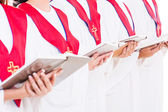 Church choir holding hymn books — Stock Photo