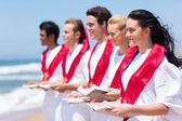 Church choir singing on the beach — Stock Photo