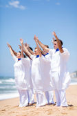 Church choir worshiping on beach — Stock Photo