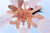 Group of friends hands together — Stock fotografie