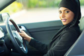 Modern muslim woman in a car — Stock Photo