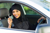 Arabian woman holding car key — Stock Photo