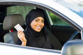 Muslim woman showing a driving license — Stock Photo