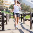 Young womjogging at beach — Stock Photo #38770785